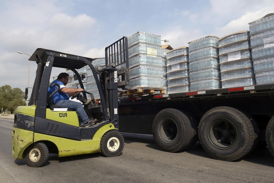 Pallets of water are loaded onto a truck for relocation July 19, 2016, on Incirlik Air Base, Turkey.  The base received many different supplies including food, fuel and water after an extended commercial power outage caused a break in the normal supply chain. (U.S. Air Force photo by Master Sgt. Derrick C. Goode)