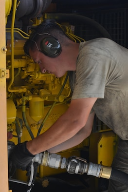 U.S. Air Force Airman 1st Class Trenton Beard, 39th Logistics Readiness Squadron fuels specialist, fills a generator with gasoline July 19, 2016, at Incirlik Air Base, Turkey. Airmen are working to sustain mission readiness around the wing. (U.S. Air Force photo by Senior Airman John Nieves Camacho)