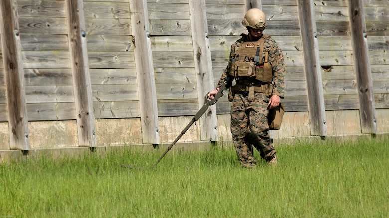 Sgt. David Jones, an explosive ordnance disposal team leader with 2nd EOD Company, 8th Engineer Support Battalion, scans the EOD lane for signs of an improvised explosive device during a training exercise at Marine Corps Base Camp Lejeune, N.C., July 19, 2016. The unit conducted the training to test the effects of different types of excavation charges. (U.S. Marine Corps photo by Lance Cpl. Victoria Ross)