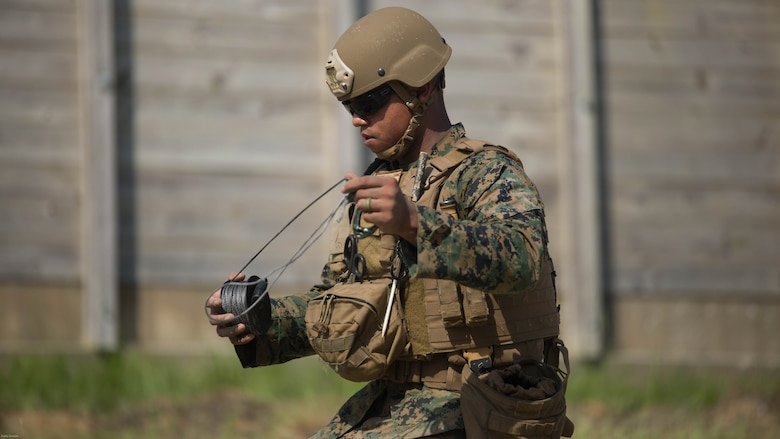 Sgt. Anthony Carbajal, an explosive ordnance disposal team leader with 2nd EOD Company, 8th Engineer Support Battalion, works on a safe detonating procedure during a training exercise at Marine Corps Base Camp Lejeune, N.C., July 19, 2016. The unit conducted the training to test the effects of different types of excavation charges.