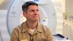 Navy Cmdr. (Dr.) Grant Bonavia, interim chief of the department of research and chief of neuroimaging and measurement devices at the National Intrepid Center of Excellence in Bethesda, Md., talks about the technology he uses to help service members and veterans with traumatic brain injuries. DoD photo by Navy Petty Officer 2nd Class Darien Kenney