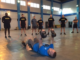 Army Command Sgt. Maj. John Wayne Troxell, right, the senior enlisted advisor to the chairman of the Joint Chiefs of Staff, leads an intense, early morning workout session at Resolute Support headquarters in Kabul, Afghanistan, July 17, 2016. DoD photo by Lisa Ferdinando