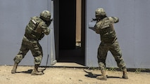 Mexican sailors clear a doorway while participating in a mechanized assault during the Southern California portion of Rim of the Pacific 2016 at Marine Corps Base Camp Pendleton, California, July 18, 2016. The purpose for the mechanized assault is so partner nations can integrate and communicate with each other for future operations. Units participating in the exercise were Marines with India Company, 3rd Battalion, 5th Marine Regiment and 3rd Assault Amphibious Battalion, both with the 1st Marine Division, and service members with the Mexican navy. Twenty-six nations, more than 40 ships and submarines, more than 200 aircraft and 25,000 personnel are participating in RIMPAC from June 30 to Aug. 4, in and around the Hawaiian Islands and Southern California. The world's largest international maritime exercise, RIMPAC provides a unique training opportunity that helps participants foster and sustain the cooperative relationships that are critical to ensuring the safety of sea lanes and security on the world's oceans. RIMPAC 2016 is the 25th exercise in the series that began in 1971.