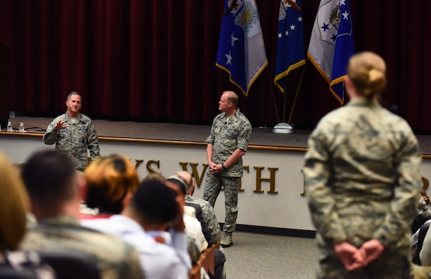 An Airman from Maxwell Air Force Base, Ala., asks Air Force Chief of Staff Gen. David L. Goldfein and Chief Master Sgt. of the Air Force James A. Cody a question during a town hall event July 20, 2016. The Air Force's two most senior leaders answered multiple questions from the audience, addressing the Airmen's concerns. (U.S. Air Force photo/Senior Airman Hailey Haux)