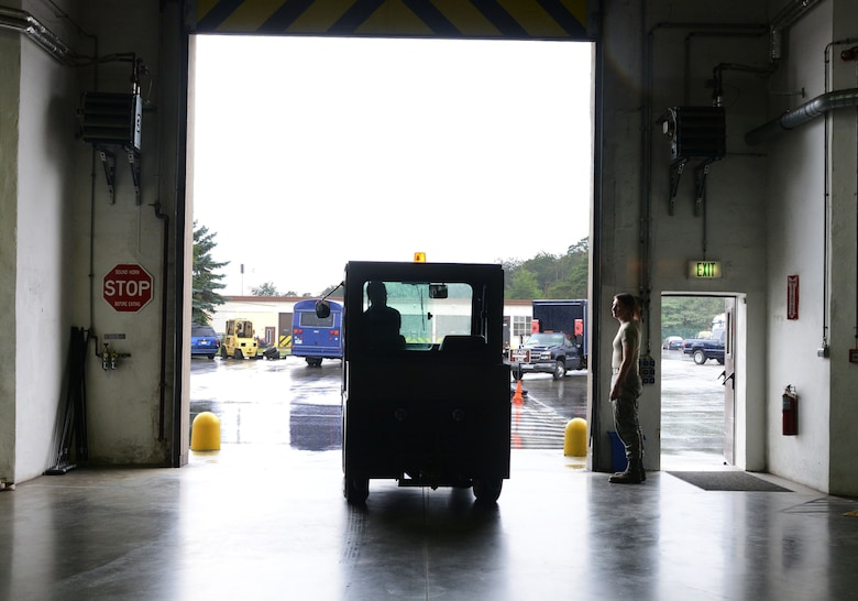 A tug vehicle exits a maintenance shop the 86th Vehicle Readiness Squadron July 13, 2016, at Ramstein Air Base. Tugs are used to push vehicles with mechanical issues to areas where they are maintained. (U.S. Air Force photo/ Airman 1st Class Joshua Magbanua)