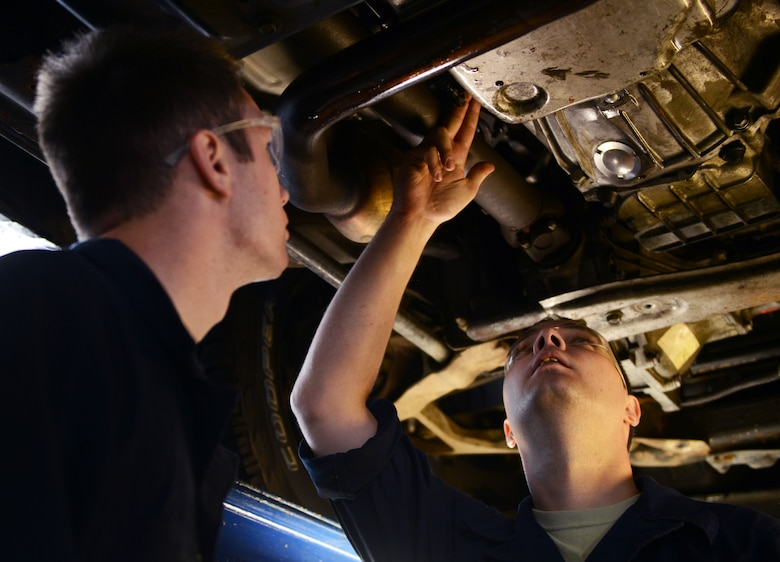 Senior Airman Zachary Caldwell and Airman 1st Class Gage Douglass, both 86th Vehicle Readiness Squadron vehicle maintainers, inspect the transmission of a pickup truck at Ramstein Air Base, Germany, July 13, 2016. The 86th VRS is responsible for keeping Ramstein's government-owned vehicles in proper working condition. (U.S. Air Force photo/ Airman 1st Class Joshua Magbanua)