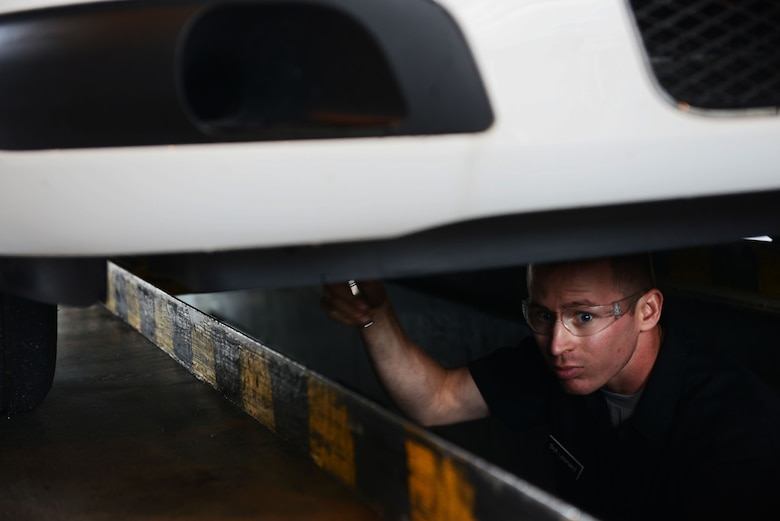 Senior Airman Ryan Leonard, 86th Vehicle Readiness Squadron vehicle maintainer, conducts maintenance work on a police vehicle at Ramstein Air Base, Germany, July 13, 2016. Airmen working at the 86th VRS must possess broad knowledge on a wide variety of vehicles made by different manufacturers. (U.S. Air Force photo/ Airman 1st Class Joshua Magbanua)