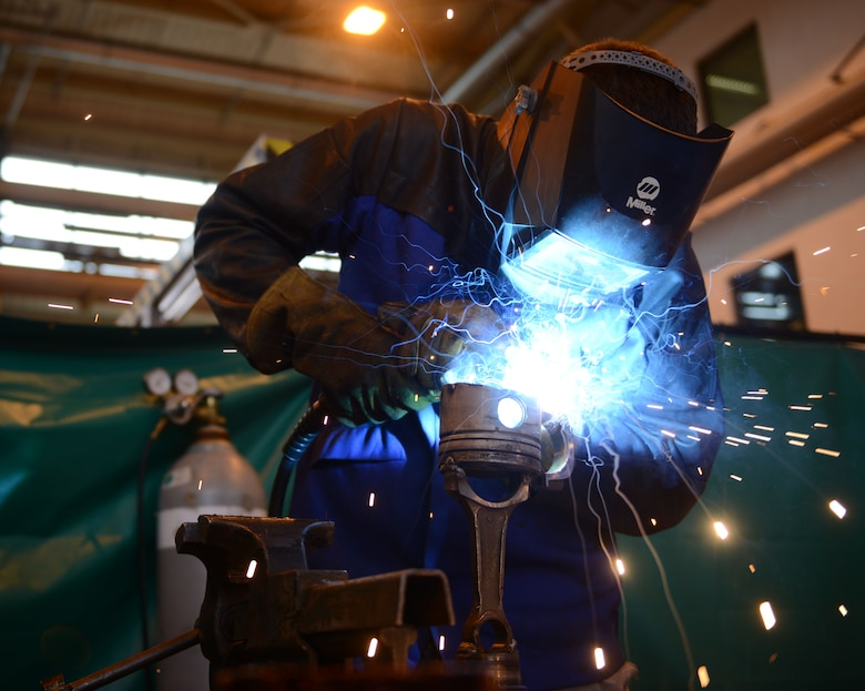 Senior Airman Adam Longfellow, 86th Vehicle Readiness Squadron vehicele maintainer, welds a friction plate at Ramstein Air Base, Germany, July 13, 2016. Airmen at the 86th VRS are responsible for ensuring Ramstein's government-owned vehicles are properly maintained and in proper working condition. (U.S. Air Force photo/ Airman 1st Class Joshua Magbanua)