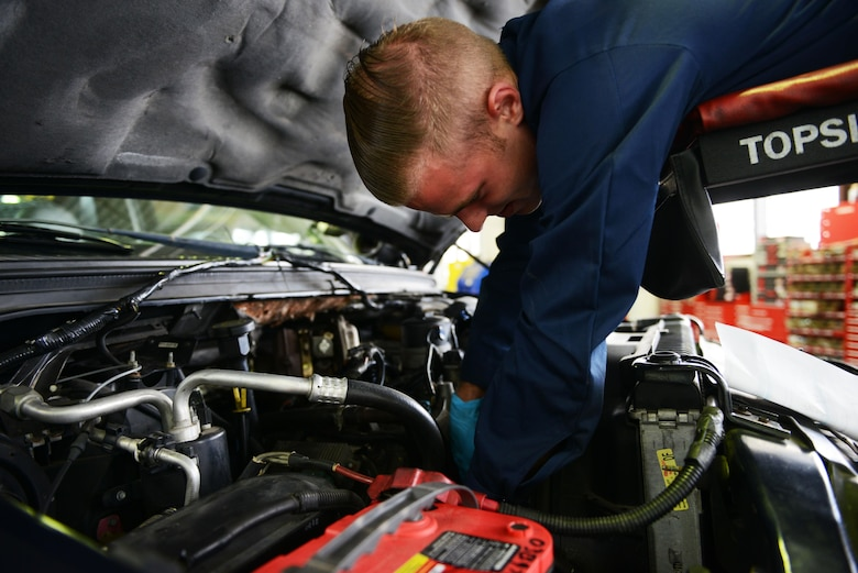 Airman 1st Class Mike Park, 86th Vehicle Readiness Squadron vehicle maintainer, guides a truck to prepare it for maintenance at Ramstein Air Base, Germany, July 13, 2016. Units all around Ramstein send their government-owned vehicles to the 86th VRS for maintenance. (U.S. Air Force photo/ Airman 1st Class Joshua Magbanua)
