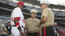 Commandant of the Marine Corps Gen. Robert B. Neller, center, speaks to Washington Nationals manager and fellow Marine veteran Dusty Baker, and Maj. Gen. John R. Ewers, before a baseball game at Nationals Park, Washington, D.C., July 20, 2016. Neller threw the ceremonial first pitch at the Washington National's annual game honoring the Marine Corps.