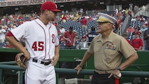 Commandant of the Marine Corps Gen. Robert B. Neller, right, speaks to Washington Nationals pitcher Blake Treinen prior to the start of a game at Nationals Park, Washington, D.C., July 20, 2016. Neller threw the ceremonial first pitch at the Washington National's annual game honoring the Marine Corps.