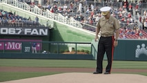 Commandant of the Marine Corps Gen. Robert B. Neller prepares to throw a baseball during a baseball game at Nationals Park, Washington, D.C., July 20, 2016. Neller threw the ceremonial first pitch at the Washington National's annual game honoring the Marine Corps.