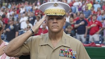 Commandant of the Marine Corps Gen. Robert B. Neller salutes during the National Anthem before a baseball game at Nationals Park, Washington, D.C., July 20, 2016. Neller threw the ceremonial first pitch at the Washington National's annual game honoring the Marine Corps.