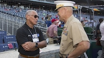 Commandant of the Marine Corps Gen. Robert B. Neller, left, speaks to NASA administrator and retired Marine Charles Bolden, before a baseball game at Nationals Park, Washington, D.C., July 20, 2016. Neller threw the ceremonial first pitch at the Washington National's annual game honoring the Marine Corps.