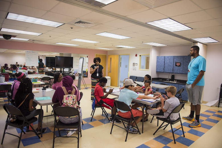 Angela Cottman, a 628th Air Base Wing master resilience trainer and BOUNCE instructor, talks to participants of the first resiliency teen camp, named BOUNCE, July 14, 2016, at the Joint Base Charleston, S.C., youth center. BOUNCE, which stands for Be optimistic, Observe thoughts, Use strengths, Never give up, Communicate effectively and Embrace you, was a weeklong camp designed to teach teens the necessary skills to overcome daily stressors associated to military families. (U.S. Air Force photo/Staff Sgt. Jared Trimarchi)