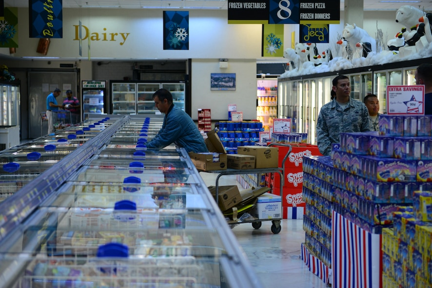 A commissary employee restocks freezer goods July 20, 2016, at Incirlik Air Base, Turkey. The Defense Commissary Agency provides goods to personnel at most base locations across the Department of Defense. (U.S. Air Force photo by Tech. Sgt. Caleb Pierce)