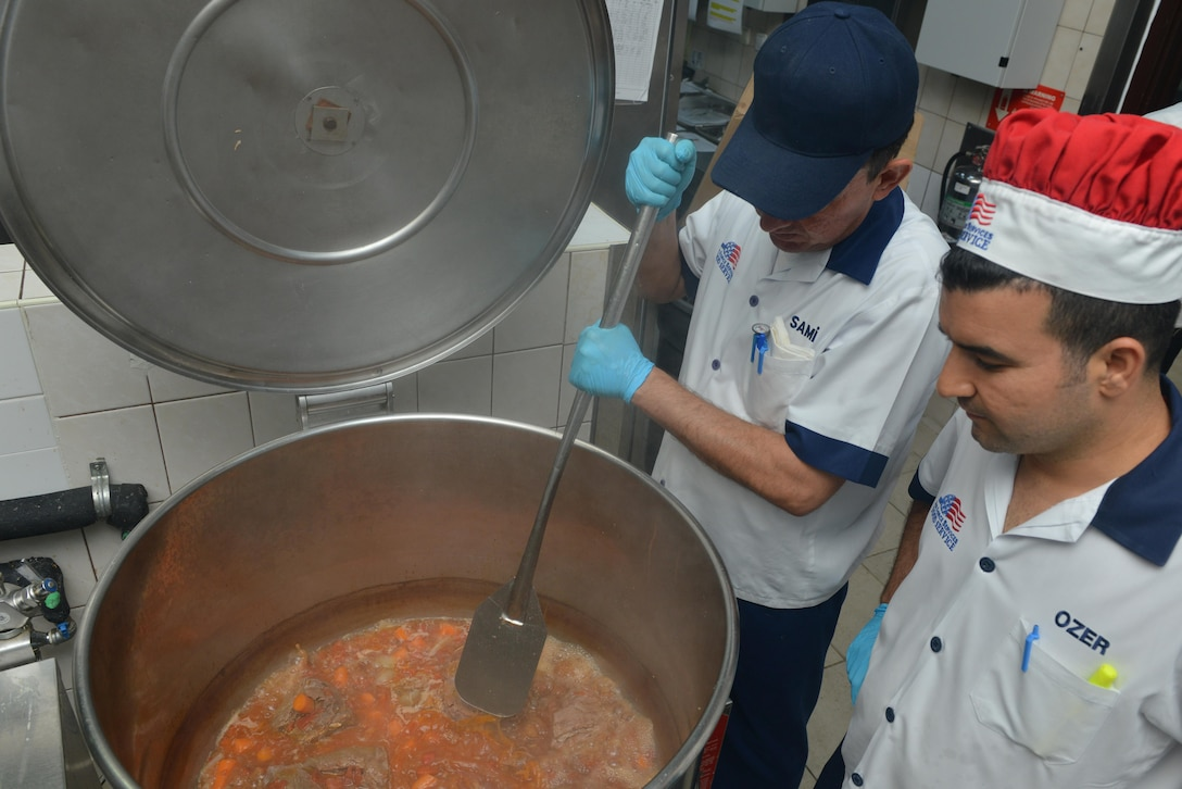 Sultan's Inn Dining Facility employees make pot roast July 21, 2016, at Incirlik Air Base, Turkey. Services employees prepare, cook and serve food for dining facility patrons. (U.S. Air Force photo by Senior Airman John Nieves Camacho)