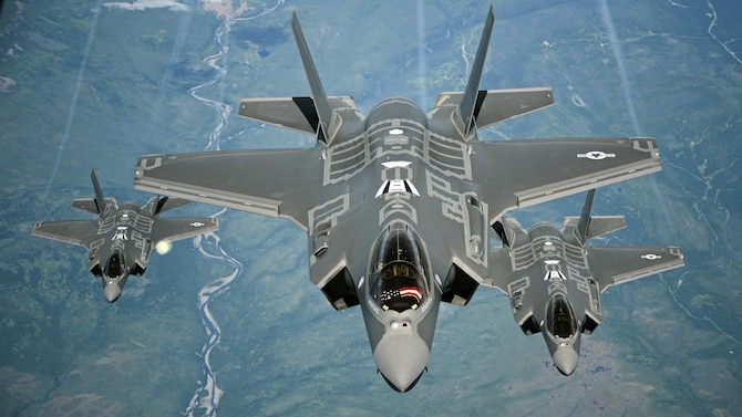 F-35A Lightning II aircraft receive fuel from a KC-10 Extender from Travis Air Force Base, Calif., July 13, 2015, during a flight from England to the U.S. The fighters were returning to Luke AFB, Ariz., after participating in the world's largest air show, the Royal International Air Tattoo. (U.S. Air Force photo/Staff Sgt. Madelyn Brown)
