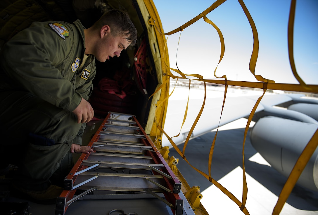 Senior Airman Jordan Webber, a KC-135 Stratotanker boom operator from MacDill Air Force Base, Fla., checks gear is where it needs to be shortly before a refueling mission at Nellis Air Force Base, Nev., July 18, 2015, during exercise Red Flag 16-3. The exercise is one of four Red Flag exercises at Nellis AFB, with this iteration focusing on multi-domain operations in air, space and cyberspace. (U.S. Air Force photo/Tech. Sgt. David Salanitri)