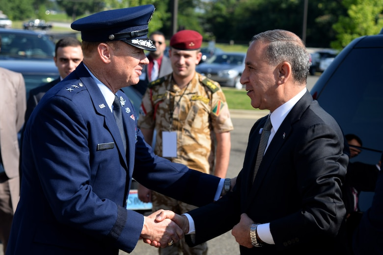 Air Force District of Washington Commander Maj. Gen. Darryl Burke greets and walks with Iraq's Defense Minister Khalid Yassin al-Obeidi as he arrives at the Gen. Jacob E. Smart Conference Center on Joint Base Andrews, Md., to attend the Counter ISIL Defense Ministerial to discuss the ongoing military campaign against ISIL with ministers of defense and other senior leaders from nations of the counter-ISIL coalition July 20 2016. (Photo by U.S. Air Force Tech. Sgt. Matt Davis)(Released)