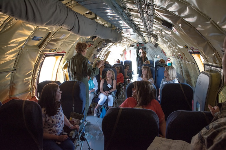 U.S. Air Force Chief Master Sgt. Kathleen Lowman, boom operator from the 18th Air Refueling Squadron, McConnell Air Force Base, Kan., briefs military spouses prior to take-off inside a KC-135 Stratotanker at Robins Air Force Base Georgia,  July 14, 2016. The spouses received the orientation flight during the Air Force Reserve Command commander's conference at Robins AFB.  (U.S. Air Force photo by Master Sgt. Eric J. Amidon)