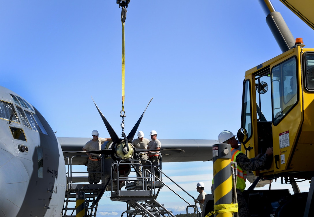 U.S. Air Force personnel from the 19th Aircraft Maintenance Squadron remove a damaged propeller on a C-130J July 21, 2016, at Joint Base Elmendorf-Richardson, Alaska. Replacing a propeller can take approximately five hours. The 19th AMXS participated in Exercise Artic Anvil where 41st Airlift Squadron C-130J aircrews conducted training in mountainous terrain. Aircraft maintenance is crucial in ensuring C-130Js are safe and certified to conduct missions.  (U.S. Air Force photo by Senior Airman Stephanie Serrano)