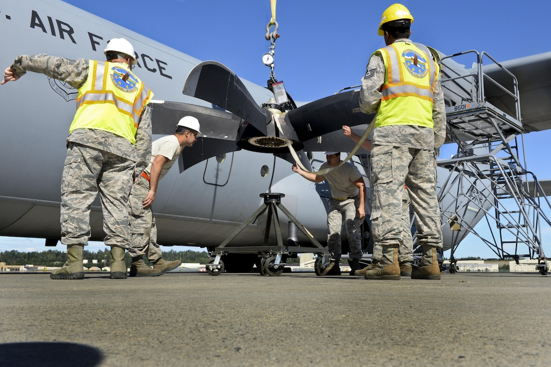 U.S. Air Force personnel secure a damaged C-130J propeller July 21, 2016, at Joint Base Elmendorf-Richardson, Alaska. The de-ice boot on the propeller failed an inspection, making it unusable. The 19th AMXS supported Exercise Artic Anvil where 41st Airlift Squadron aircrews conducted training to ensure combat airlift can be executed in a multitude of environments. (U.S. Air Force photo by Senior Airman Stephanie Serrano)
