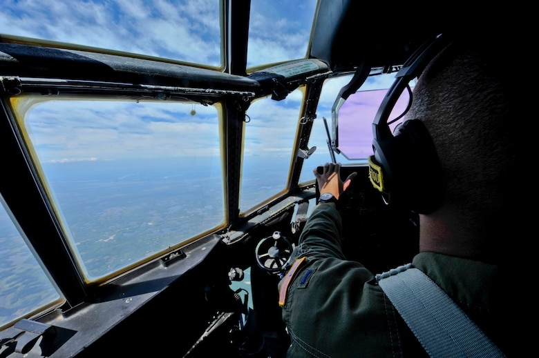 U.S. Air Force 1st Lt. Joshua Travis, 41st Airlift Squadron C-130J pilot, flies a C-130J July 17, 2016, over Alaska. C-130J aircrews from the 41st AS routinely travel across the world to ensure combat airlift can be executed globally in a moment's notice. (U.S. Air Force photo by Senior Airman Stephanie Serrano)