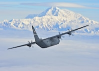 A C-130J from the 41st Airlift Squadron flies past Denali National Park's highest peak in North America July 19, 2016. Team Little Rock delivers combat airlift to Alaska as part  pre-deployment training. The 41st AS is conducting training in Alaska to prepare for the terrain present in austere locations. Alaska provides an uncontended airspace which allows aircrews to train more effectively without having to adjust to commercial flight patterns. (U.S. Air Force photo by Senior Airman Kaylee Clark)
