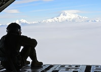 U.S. Air Force Senior Airman Jordon Speedy, 41st Airlift Squadron loadmaster, overlooks the Alaskan landscape July 19, 2016. The 41st AS is conducting training in Alaska to prepare for the terrain present in austere locations. Alaska provides an uncontended airspace which allows aircrews to train more effectively without having to adjust to commercial flight patterns. (U.S. Air Force photo by Senior Airman Kaylee Clark)