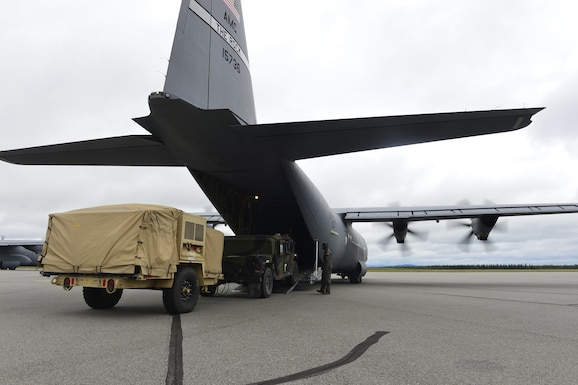 U.S. Air Force personnel work alongside U.S. Army personnel to load a Humvee into the back hull of a C-130J from the 41st Airlift Squadron from Little Rock Air Force Base, Ark., July 19, 2016, at Ladd Army Airfield, Alaska, in support of exercise Arctic Anvil. Arctic Anvil is an integrated combined, joint and coalition training event integrating the U.S Air Force, U.S. Army Alaska, Alaska National Guard, Iowa National Guard, 196th Infantry Brigade and the Canadian military. (U.S. Air Force photo by Senior Airman Kaylee Clark)