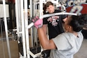 Staff Sgt. Tamika Hamilton, 60th Logistics Readiness Squadron customer service support, works out July 8 with her off-base trainer, Kevin Pulsipher. Hamilton changed her workout routine after giving birth in October 2015.