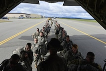 U.S Army Soldiers board a C-130J from the 41st Airlift Squadron and are later inserted into a simulated forward operating base in Alaska to provide realistic conditions in deployed locations on July 20, 2016. Arctic Anvil is an integrated combined, joint and coalition training event integrating the U.S Air Force, U.S. Army Alaska, Alaska National Guard, Iowa National Guard, 196th Infantry Brigade and the Canadian military. (U.S. Air Force photo by Senior Airman Kaylee Clark)