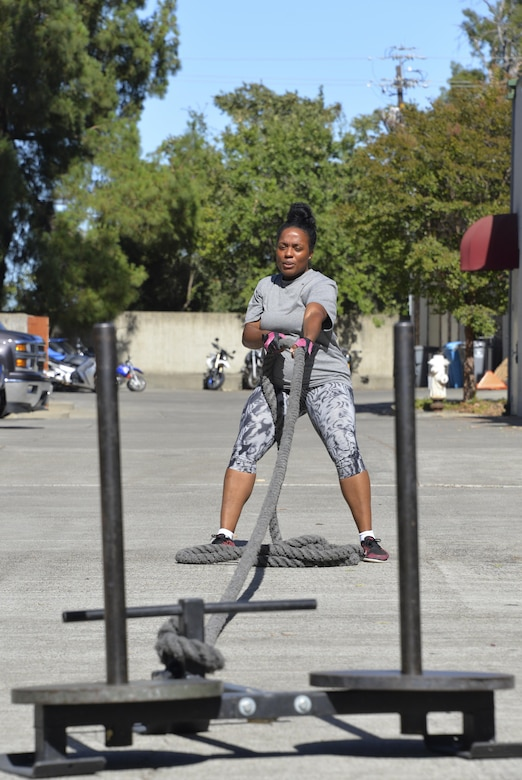 Staff Sgt. Tamika Hamilton, 60th Logistics Readiness Squadron customer service support, pushes herself July 8 during her new workout routine.