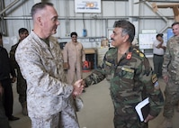Marine Gen. Joseph F. Dunford Jr., chairman of the Joint Chiefs of Staff, meets with Afghan Air Force Brig. Gen. Eng A. Shafi, during an assessment of the Train, Advise, Assist Command-Air (TAAC-Air), in Kabul, Afghanistan, July 16th, 2016. Dunford met with key leadership and received briefings about the progress of the Afghan air force and its partnership with TAAC-Air as part of his overall assessment of the Resolute Support mission. DoD Photo by Navy Petty Officer 2nd Class Dominique A. Pineiro