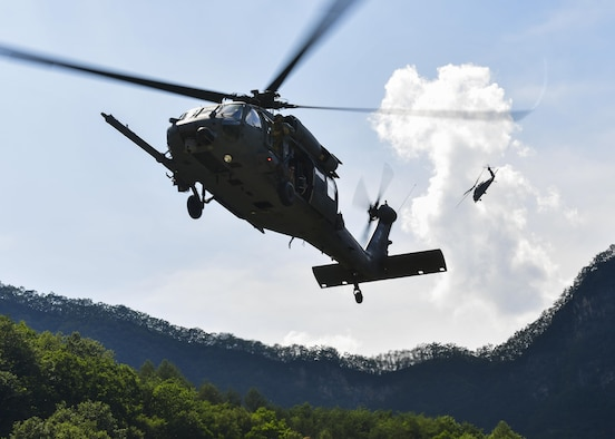 An HH-60 Pave Hawk assigned to the 33rd Rescue Squadron, Kadena Air Base, Japan, descends for a landing while a second HH-60 provides aerial coverage from above during a combat search and rescue training mission during Exercise Pacific Thunder 16-2 in the Republic of Korea, July 19, 2016. The two-week long exercise brought together units from around Pacific Air Forces to train aircrews and commanders to validate tactics, techniques and procedures used for CSAR and suppression of enemy air defense. (U.S. Air Force photo by Senior Airman Victor J. Caputo/Released)