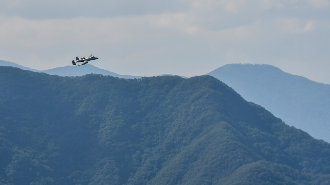 An A-10 Thunderbolt II assigned to the 25th Fighter Squadron crests over a hill while providing air coverage for a combat search and rescue team during Exercise Pacific Thunder 16-2 in the Republic of Korea, July 19, 2016. The two-week long combined exercise is designed to train U.S. and ROK aircrews and commanders to validate tactics, techniques and procedures used for CSAR and suppression of enemy air defense. The units and aircraft involved in the exercise include A-10s and F-16 Fighting Falcons from the 51st Fighter Wing, Osan Air Base, Republic of Korea; F-16s from the 8th Fighter Wing, Kunsan Air Base, ROK; HH-60 Pave Hawks, E-3 Sentrys, and a KC-135 Stratotanker from the 18th Wing, Kadena AB, Japan; and U-2 Dragon Ladys from 7th Air Force alongside more than 200 ROK air force personnel and 22 ROKAF aircraft. (U.S. Air Force photo by Senior Airman Victor J. Caputo/Released)