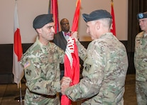 Maj. Gen. Richard L. Stevens (right), deputy commanding general of the U.S. Army Corps of Engineers passes the Corps flag to Col. Rafael F. Pazos, incoming commander of the Corps' Japan District during a Change of Command Ceremony, July 8, 2016. The passing of the colors symbolizes the formal relinquishing of command from outgoing commander Col. John S. Hurley to incoming commander Pazos. (USACE Photos)