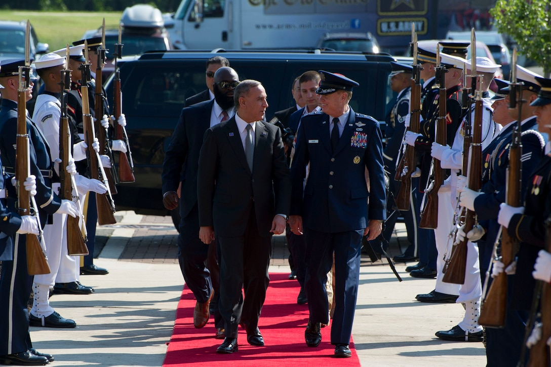Air Force District of Washington Commander Maj. Gen. Darryl Burke greets and walks with Iraq's Defense Minister Khalid Yassin al-Obeidi as he arrives at the Gen. Jacob E. Smart Conference Center on Joint Base Andrews, Md., to attend the Counter ISIL Defense Ministerial to discuss the ongoing military campaign against ISIL with ministers of defense and other senior leaders from nations of the counter-ISIL coalition July 20 2016. (Photo by U.S. Air Force Senior Master Sgt. Adrian Cadiz)(Released)