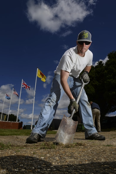 U.S. Air Force Tech. Sgt. David West, 100th Civil Engineer Squadron commander support staff NCO, uses a shovel to remove weeds from a side walk July 17, 2016, at the RAF Rougham Tower Museum in Bury St. Edmunds, England. West and other members from Team Mildenhall's Air Force Sergeants Association volunteered to clean up the museum. (U.S. Air Force photo by Staff Sgt. Micaiah Anthony)