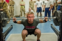 Peter Olsen, a Defense Department civilian, participates in the squat event portion of a powerlifting competition at Bagram Airfield, Afghanistan, July 15, 2016. Olsen is assigned to the 455th Expeditionary Aircraft Maintenance Squadron. Air Force photo by Capt. Korey Fratini