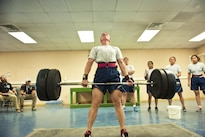 Air Force Master Sgt. Lindsey Glover lifts a barbell while performing a deadlift during a powerlifting competition at Bagram Airfield, Afghanistan, July 15, 2016. Glover is assigned to the 455th Expeditionary Aircraft Maintenance Squadron. Air Force photo by Capt. Korey Fratini