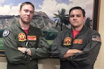 Navy Chief Petty Officer Jason Lessley, left, and Navy Petty Officer 2nd Class Hunter Price, both with Helicopter Sea Combat Squadron 15, provided emergency care to a tourist in medical distress on the Diamond Head Trail in Honolulu, July 12, 2016. Navy photo
