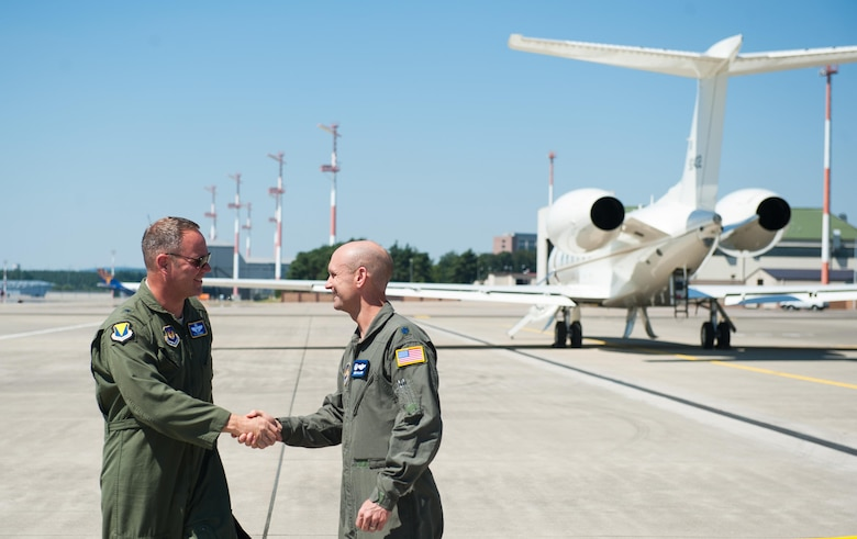 Brig. Gen. Jon T. Thomas, 86th Airlift Wing commander, greets Lt. Col. Derek Gallagher, 76th Airlift Squadron commander, before taking off for his final flight as the 86th AW commander July 19, 2016, at Ramstein Air Base, Germany. Thomas has served in the 86th AW for one year and will be moving on to Scott Air Force Base, Illinois. (U.S. Air force photo/Airman 1st Class Lane T. Plummer)