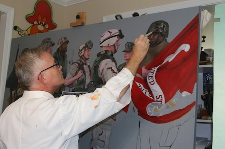 Kristopher Battles, a veteran Marine combat artist, works on the painting he was commissioned to paint for the Centennial celebration of the U.S. Marine Corps Reserves in his Spotsylvania, Va. studio July 18.
