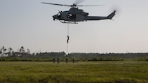 Marine students with the Fast Rope Masters Course, ran by Expeditionary Operations Training Group rappel from a UH-Y1 Huey helicopter during elevator drills at Landing Zone Kingfisher, Marine Corps Base Camp Lejeune, N.C., July 13, 2016. The week-long course is the first of its kind and focuses on qualifying Marines as subject matter experts and gives them the ability to execute fast rope training within their subordinate command.