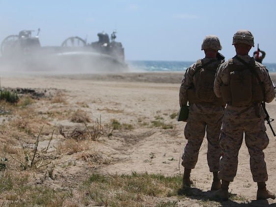 U.S. Marines with Landing Support Company, 1st Transportation Support Battalion, 1st Marine Logistics Group, observe the beaching of a landing craft, air cushion during PACOM Amphibious Leaders Symposium – 16 aboard Camp Pendleton, Calif., July 13, 2016. Several 1st MLG units and Beachmaster Unit 1, Naval Beach Group 1 facilitated the offload of equipment and personnel during the symposium's beach landing operations demonstration. (U.S. Marine Corps photo by Sgt. Carson Gramley/released)