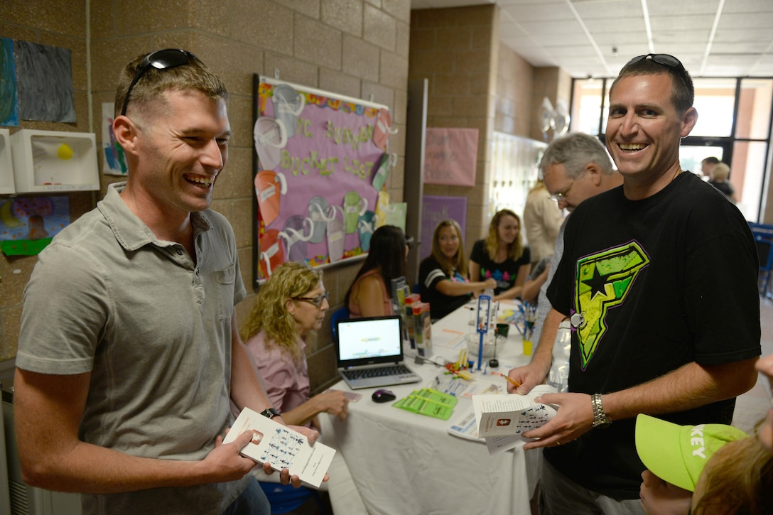 Staff Sgt. Robert Kusina, 365th Training Squadron avionics instructor, welcomes Tech. Sgt. Steven Dymond, 82nd Comptroller Squadron NCO in charge of customer support, to Sheppard Air Force Base, Texas, during the summer family picnic, July 20, 2016. The summer family picnic had several booths from various helping agencies to welcome and introduce new families to the base. (U.S. Air Force photo by Senior Airman Kyle E. Gese/Released)