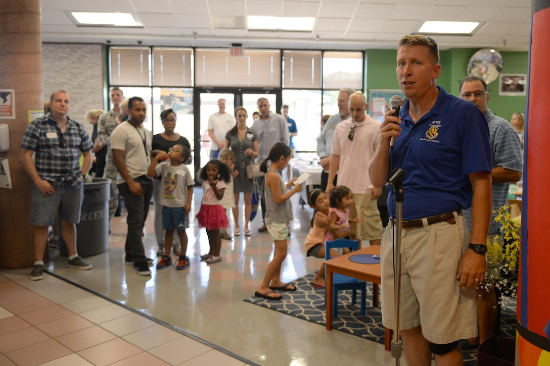 Brig. Gen. Patrick Doherty, 82nd Training Wing commander, welcomes new families to Sheppard Air Force Base, Texas, during the summer picnic, July 20, 2016. The picnic hosted several base helping agencies to welcome new families to the base and community. (U.S. Air Force photo by Senior Airman Kyle E. Gese/Released)