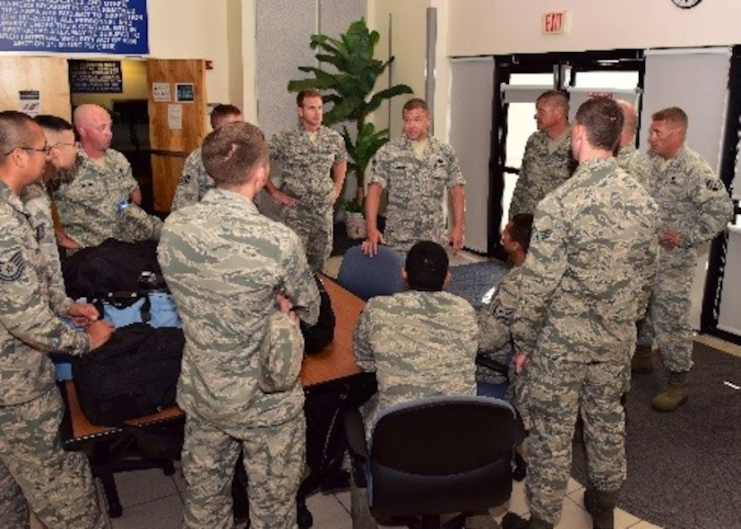 Chief Master Sgt. Jamie Cornelia, 924th Maintenance Squadron, talks to newly arriving Airmen from Davis-Monthan Air Force Base, Ariz. to Patrick Air Force Base, Fla., July 14 about scheduled events during their deployment. Citizen Airmen with the 924th Fighter Group, Davis-Monthan AFB and the 920th Rescue Wing at Patrick AFB, are training together to perfect skills needed during combat.